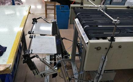 自动收料装置在服装加工粘衬技术中的应用